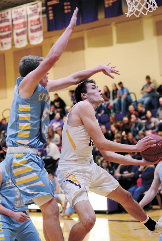 T-R PHOTO BY ROSS THEDE • East Marshall senior Zaine Leedom, right, is fouled on his drive to the basket by Lynnville-Sully's Jesse Van Wyk during the first quarter of Saturday's basketball game in Le Grand. Leedom scored 12 of his 14 points in the first half as the Mustangs handled the visiting Hawks 58-36.