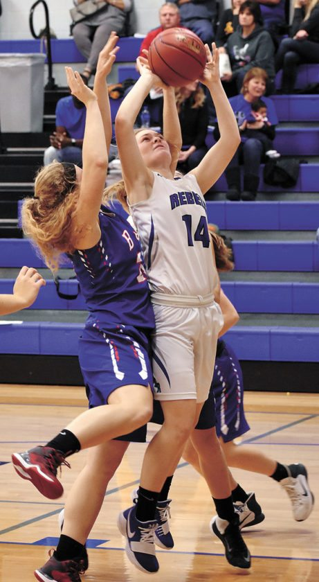 T-R PHOTO BY THORN COMPTON • Gladbrook-Reinbeck junior Taylor Gienger (14) puts up a shot despite contact from BGM's Lyla Kriegel during the Rebels' 46-44 comeback win on Saturday over the Bears.