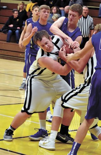 T-R PHOTO BY THORN COMPTON • BCLUW senior Keegan Rhinehart, left, fights for a rebound during the Comets' loss to Montezuma at home on Monday night.