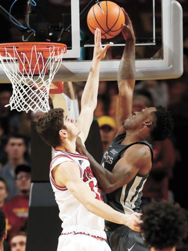 AP PHOTO • Iowa State forward Cameron Lard, right, dunks the ball over Northern Illinois guard Anastasios Demogerontas during the second half of an NCAA college basketball game, Monday at Hilton Coliseum in Ames.
