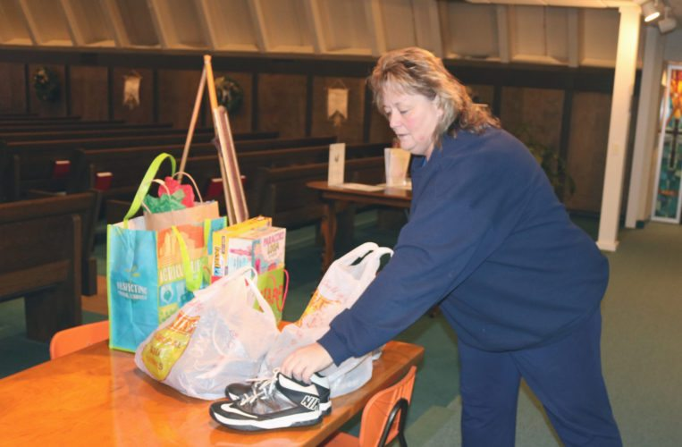 T-R PHOTO BY ADAM SODDERS Gently-used shoes, clothes, toys and more were donated to the Holiday Service Project drop-off Tuesday evening at Trinity Lutheran Church. The church will also host the next drop-off, set for 4-5:30 p.m. Dec. 13.