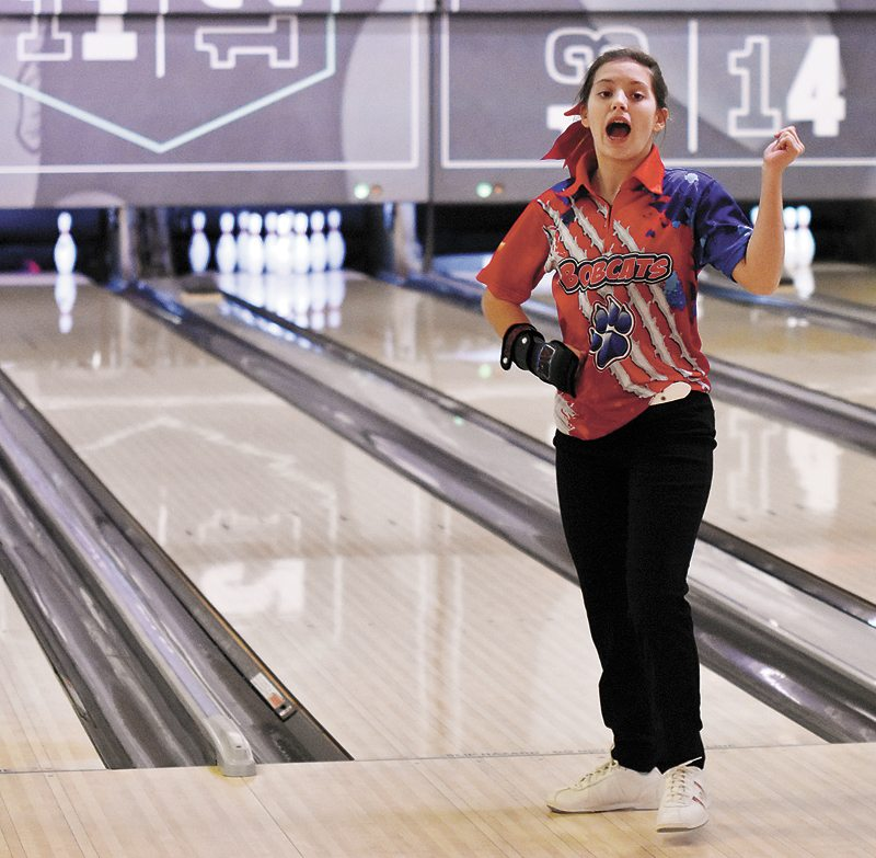 T-R PHOTO BY THORN COMPTON • Marshalltown sophomore Ashly Wiegand promises her team she will pick up the spare she left during the baker games in Tuesday's win over Des Moines Roosevelt. Wiegand would proceed to pick up the spare.