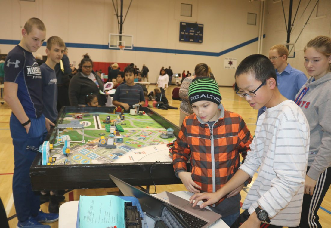 T-R PHOTO BY ADAM SODDERS The Miller Middle School gymnasium buzzed with students and parents enjoying Family Coding Night Wednesday, with several coding and robotics activities led by students. This is the second year of the event held as part of the national Computer Science Education Week.