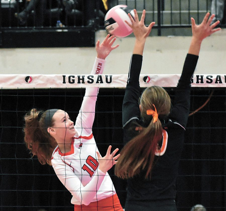T-R FILE PHOTO • North Tama sophomore right-side hitter Katie Kopriva, left, sends an attack over the net during the Redhawks' Class 1A state volleyball tournament quarterfinal match against Springville on Nov. 8 at the U.S. Cellular Center in Cedar Rapids.