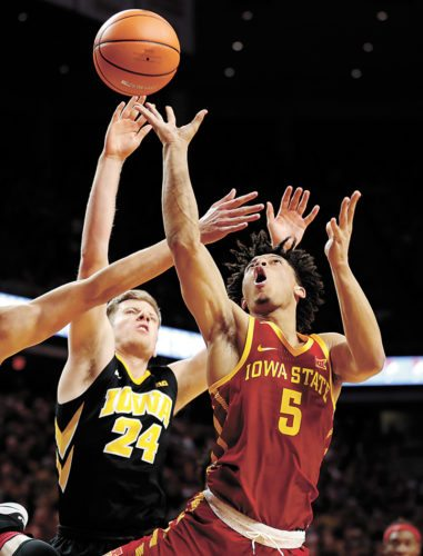 AP PHOTO • Iowa State guard Lindell Wigginton (5) shoots over Iowa's Brady Ellingson (24) during the first half of a college basketball game Thursday at Hilton Coliseum in Ames.