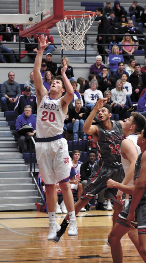 T-R PHOTO BY THORN COMPTON • Marshalltown senior Josh Melde (20) puts up a shot after hauling down a rebound during the second quarter of the Bobcats' loss to Fort Dodge on Friday.