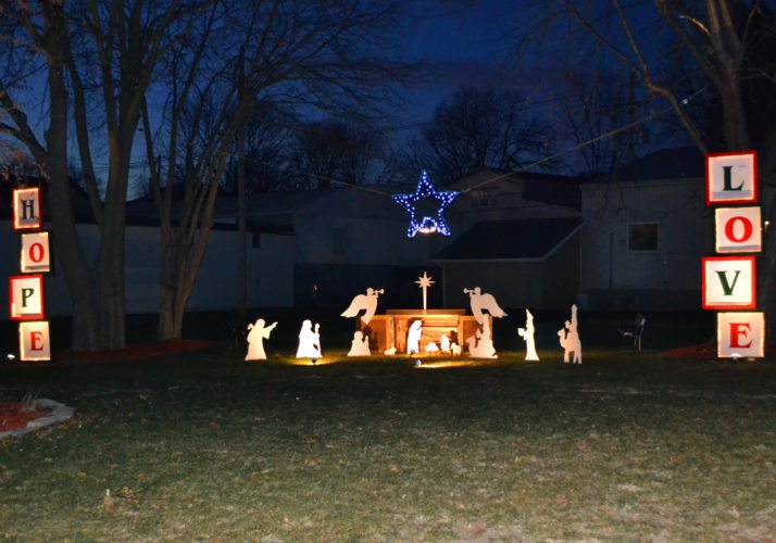 "Folks traveling down West Linn Street are greeted with the sight of a lighted nativity scene and messages of ""hope, love and joy"" spelled out in glowing blocks. The Christmas display, set up on the grounds of the former St. Mary Convent, and adjacent to the church, was provided by Dorothy and Dick Schrad."