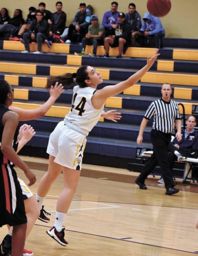 T-R PHOTO BY THORN COMPTON • Marshalltown Community College freshman Maria Cruz Uceda (44) scoops home a shot during the second half of the Tigers' loss to Southeastern Community College on Monday. Uceda scored a career-high 13 points in the loss.