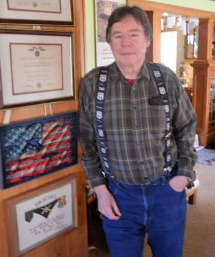 T-R PHOTO BY CHUCK FRIEND Vietnam veteran Tom LaVille of Marshalltown stands next to some of his medals and awards received while in the military service in the 1960s.