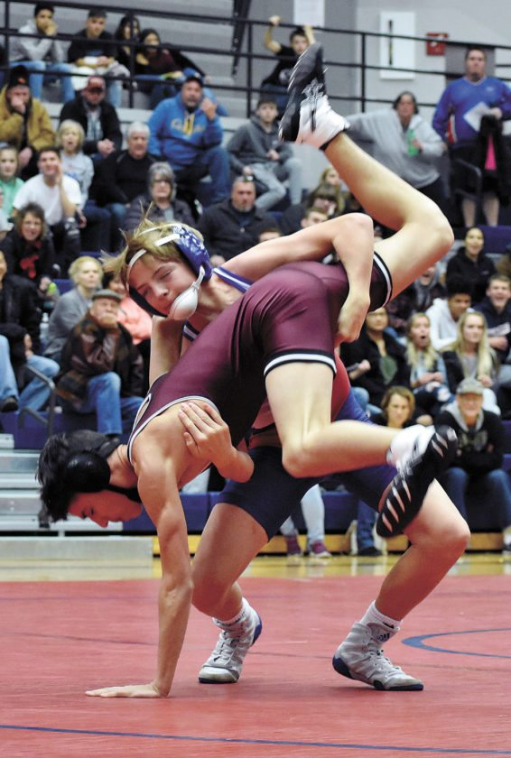T-R PHOTO BY THORN COMPTON • Marshalltown sophomore Bennett Hageman topples Dowling Catholic's Isaiah James during their 106-pound match in the Bobcats' 45-26 dual win over the Maroons on Thursday night at the Roundhouse. Hageman won the match with a third-round pin.