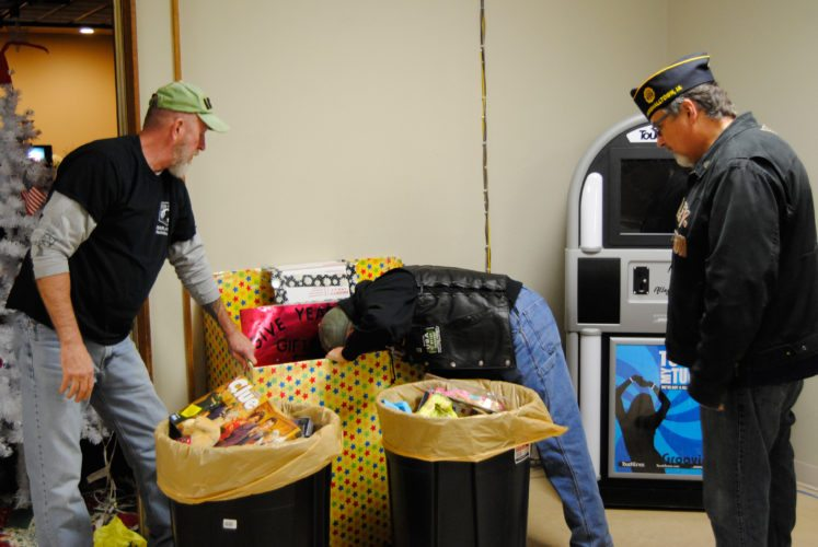 American Legion Riders Post 46 members, from left, Mike Ball, Pet Petit and Randy Kessler, collected donated toys to deliver to the Blank Children's Hospital in Des Moines. The Riders have been collecting a variety of toys throughout the year and bagged up the donations on Friday morning.