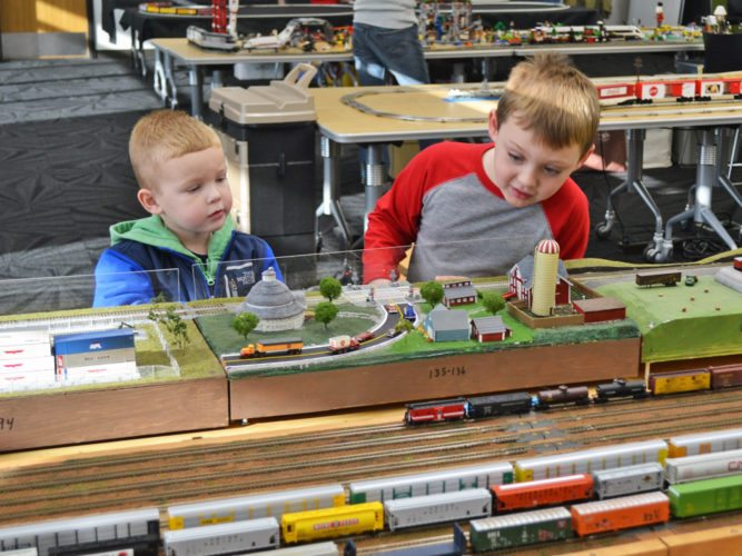 Several train displays were set up inside the Marshalltown Public Library's meeting room on Saturday, showcasing the model train sets of the Central Iowa Modular Railroad club. Youngsters of all ages oohed and aahed, watching toy trains run on tracks, light up and make noise. Jack Cross, 4, left, and Zachary Teig, 4, right, were two such attendees. The fun continues today, with the displays set up from 1-3 p.m.