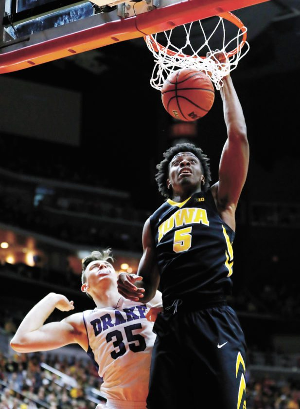 AP PHOTO • Iowa forward Tyler Cook (5) dunks the ball in front of Drake forward Nick McGlynn (35) during the second half of a college basketball game Saturday at Wells Fargo Arena in Des Moines. Cook scored 23 points as Iowa won 90-64.