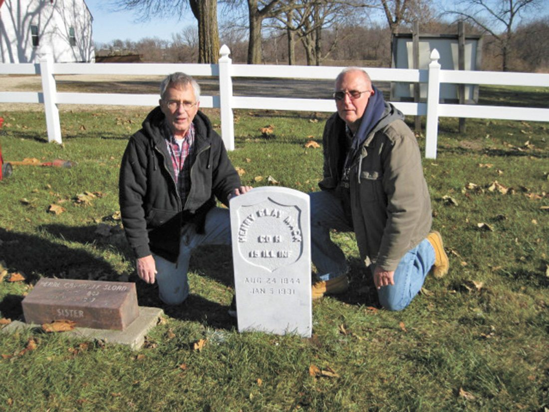 Dan Brandt, left, was able to secure a headstone for Civil War veteran Henry Clay Mack. He's pictured installing the marker alongside friend Larry Wilkening.