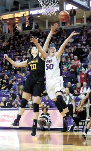 AP PHOTO • Northern Iowa's Megan Maahs (50) tries to score around Iowa's Megan Gustafson (10) during a women's college basketball game Sunday at the McLeod Center in Cedar Falls.