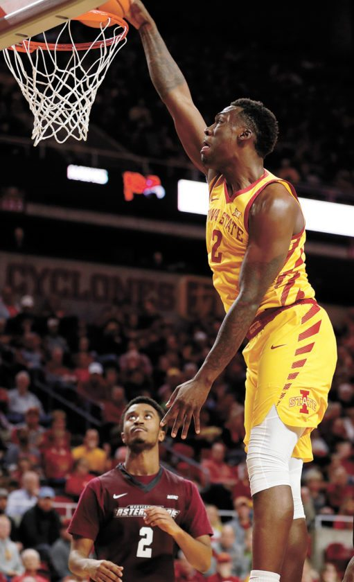 AP PHOTO • Iowa State forward Cameron Lard, right, dunks the ball over Maryland-Eastern Shore's Cameron Bacote during the second half of a college basketball game Wednesday at Hilton Coliseum in Ames. Lard scored 15 points as Iowa State won 55-49.