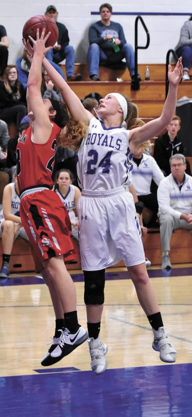 T-R PHOTO BY THORN COMPTON • Colo-NESCO sophomore Rylee Purvis (24) fights for a rebound with South Hardin senior Paige Harrell during the first half of the Royals' 63-47 win over the Tigers in Colo on Thursday.