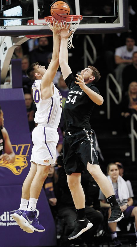 AP PHOTO • Northern Iowa forward Austin Phyfe goes up for a rebound with Xavier forward Sean O'Mara, right, during the second half of a college basketball game Friday at the McLeod Center in Cedar Falls.
