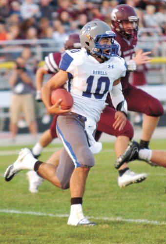 T-R FILE PHOTO • Gladbrook-Reinbeck senior quarterback Hunter Lott runs for a gain against Grundy Center during their season-opening football game Aug. 25 in Grundy Center.
