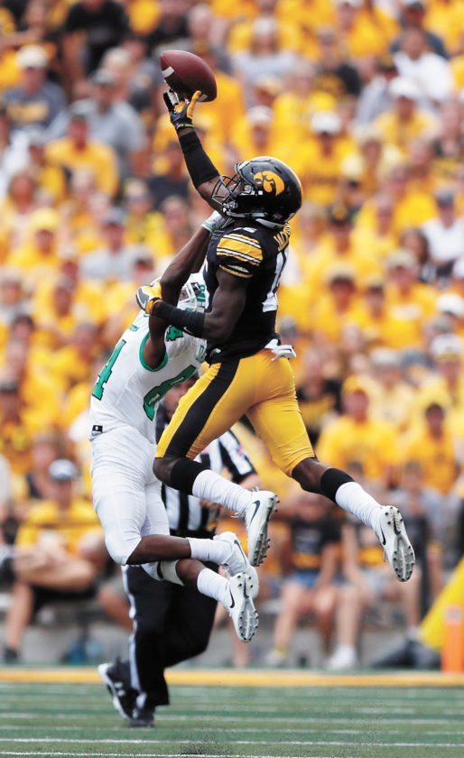 AP FILE PHOTO • Iowa defensive back Josh Jackson breaks up a pass intended for North Texas wide receiver Jaelon Darden, left, during the first half of college football game Sept. 16 in Iowa City.