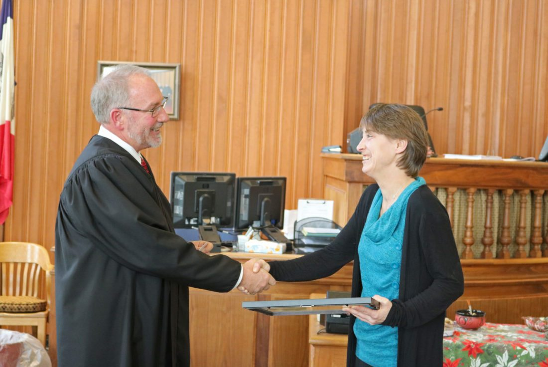 T-R PHOTO BY ADAM SODDERS Lisa Hickman was all smiles Friday as she celebrated her graduation from the Enhanced Supervision Court led by District Court Judge John Haney. It was another step in a long journey since Hickman began the program in the summer of 2016, after she had several drug-related run-ins with the law.