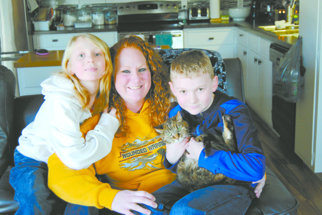T-R PHOTO BY JEFF HUTTON Shelby Pennington enjoys a quiet day at home with her children Zarhona, left, and Zander.