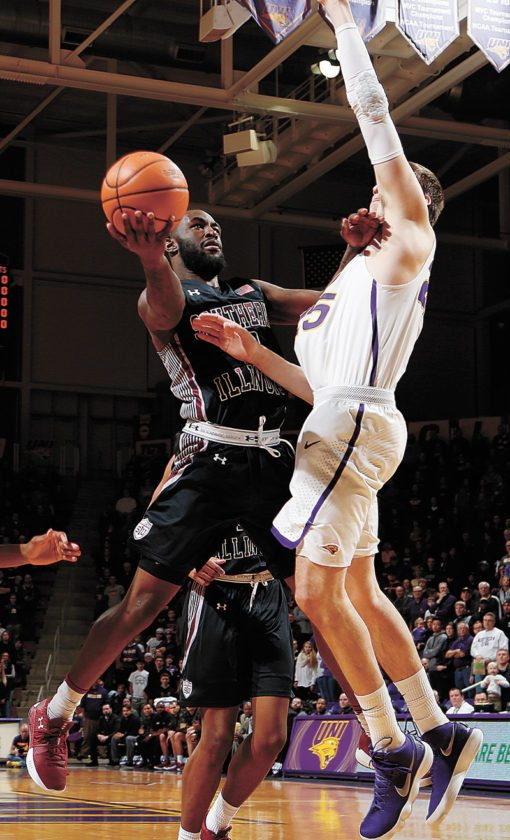 AP PHOTO • Southern Illinois' Sean Lloyd, left, shoots against Northern Iowa defender Bennett Koch in the first half of their Missouri Valley Conference basketball game Thursday at the McLeod Center in Cedar Falls.
