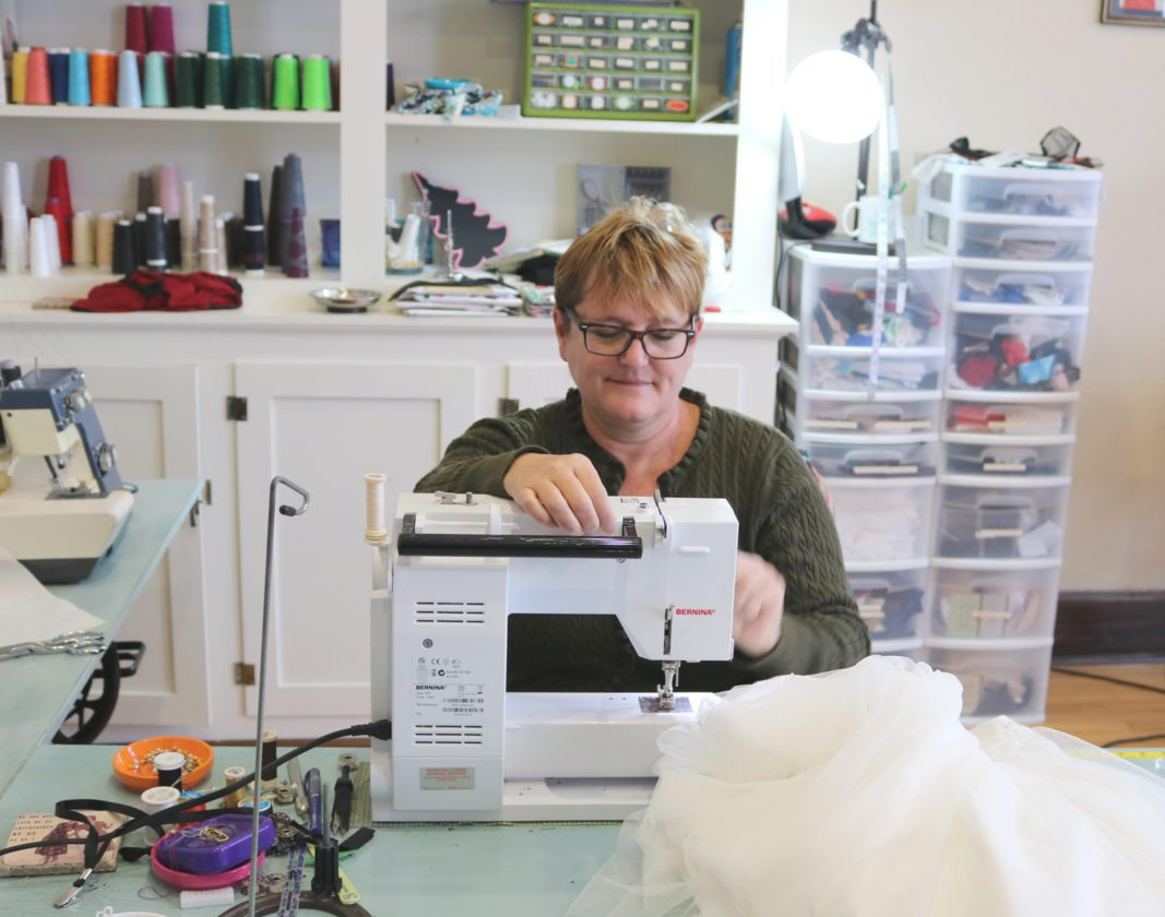 Ashley Kelber works hard to fix fabrics and garments at Just Sew in State Center; she said she has been sewing since she was 9 years old. Kelber often repairs fabrics, and can make additions and alterations to clothing items; she is available by appointment.