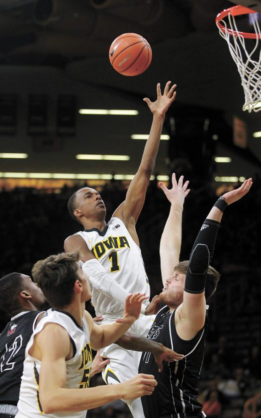 AP PHOTO • Iowa's Maishe Dailey goes up to shoot against Northern Illinois during a college basketball game Friday at Carver-Hawkeye Arena in Iowa City. The host Hawkeyes beat the Huskies 98-75.