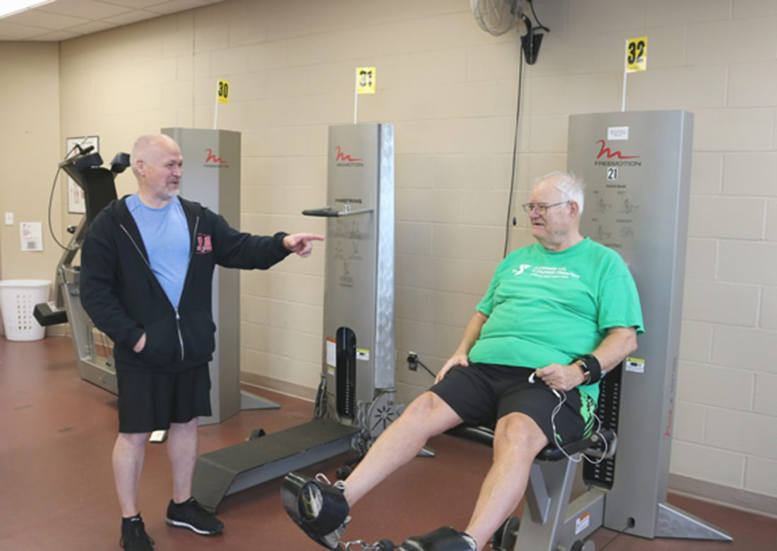 Marshalltown resident Bill Earney enjoys getting in a workout, even with snow falling heavily outside. Marshalltown YMCA-YWCA Health and Wellness coordinator Curt Shaver helps several people get into and stay in shape.