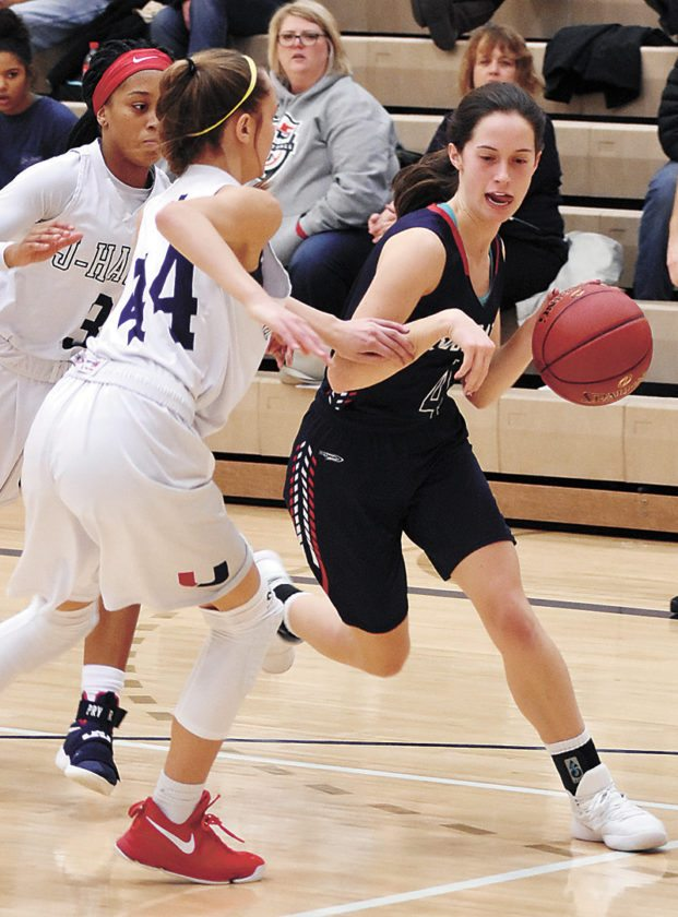 T-R PHOTO BY THORN COMPTON • Marshalltown sophomore Erica Johnson, right, drives the lane on Urbandale's Madi Lynch (44) during the Bobcats' road loss to the J-Hawks on Tuesday night.