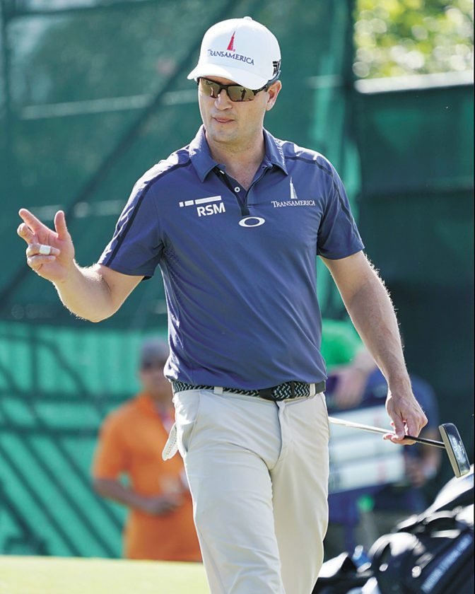 AP PHOTO • Zach Johnson waves to the gallery off the eighth green during the first round of the Sony Open golf tournament Thursday in Honolulu.