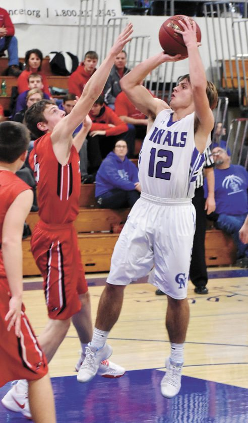 T-R PHOTO BY THORN COMPTON • Colo-NESCO senior Philip Bower (12) shoots a jumper over North Tama defender Hale Hulme during the Royals' Iowa Star Conference South Division win against the Redhawks on Friday night.