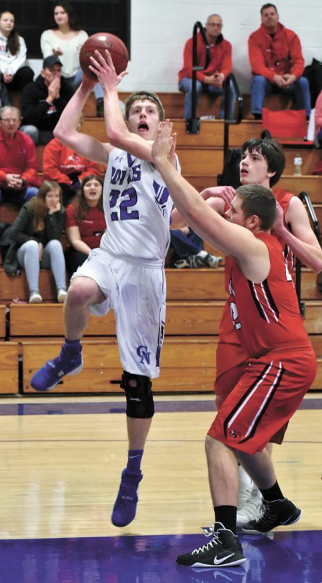 T-R PHOTO BY THORN COMPTON • Colo-NESCO senior Matthew Hill (22) sends up a shot from the block while North Tama defenders Cael Even, behind, and Cael Even attempt to contest during the first half of the Royals win over the Redhawks on Friday night.