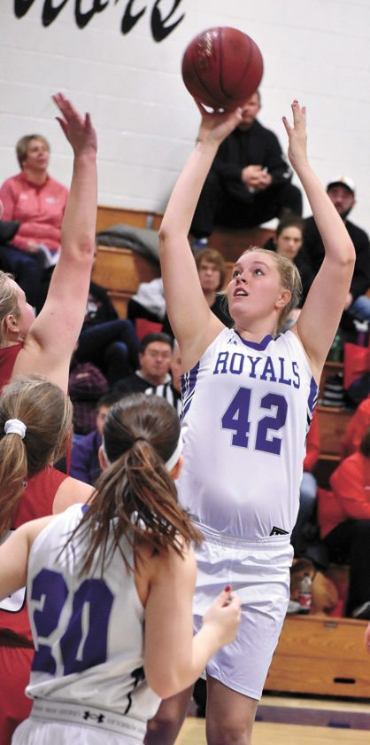 T-R PHOTO BY THORN COMPTON • Colo-NESCO sophomore Emma Stalzer (42) puts sends a shot toward the basket in the first half of the Royals' big 65-24 win over North Tama on Friday night.