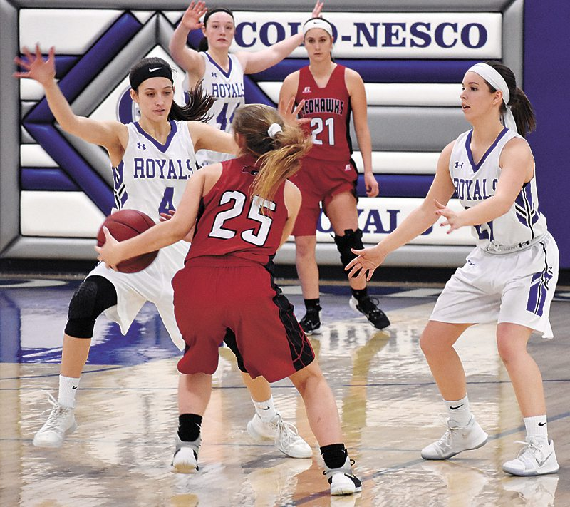 T-R PHOTO BY THORN COMPTON • Colo-NESCO defenders Lauryn Hill (4) and Chelsea Henze, left, set a trap on North Tama guard Takoa Kopriva (25) during the Royals' win of the Redhawks in Colo on Friday night.