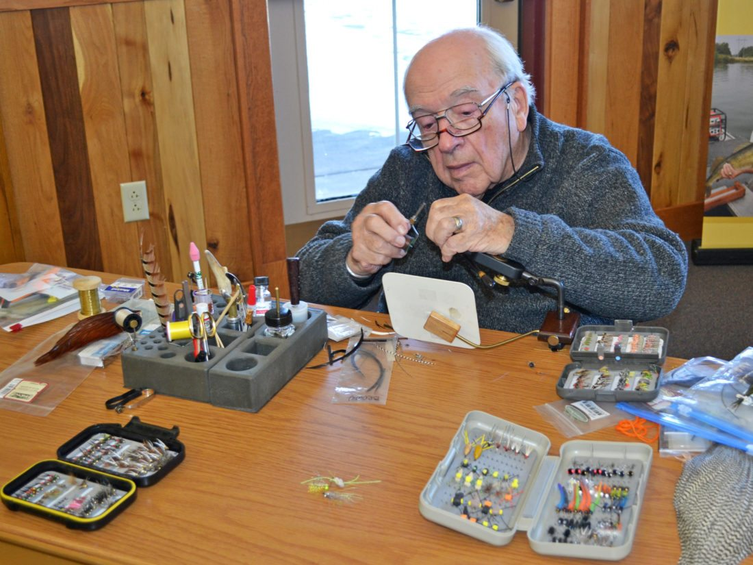 "Saturday morning at Grimes Farm and Conservation Center, fishing enthusiasts attended the free, annual fishing lure making seminar, hosted by the Marshall County Conservation Board (MCCB). Dean Elder, picutred, showed attendees how to tie flies, such as the Prince Nymph. Jim Wiegand demonstrated how he makes jigs, spinner baits and finishes off crank baits, while Mike Stegmann showed how to mold, cast and paint crank baits made to look like the classic models of years gone by. ""We had a great turnout, especially with kids that came to get spinner bait kits,"" Stegmann said."