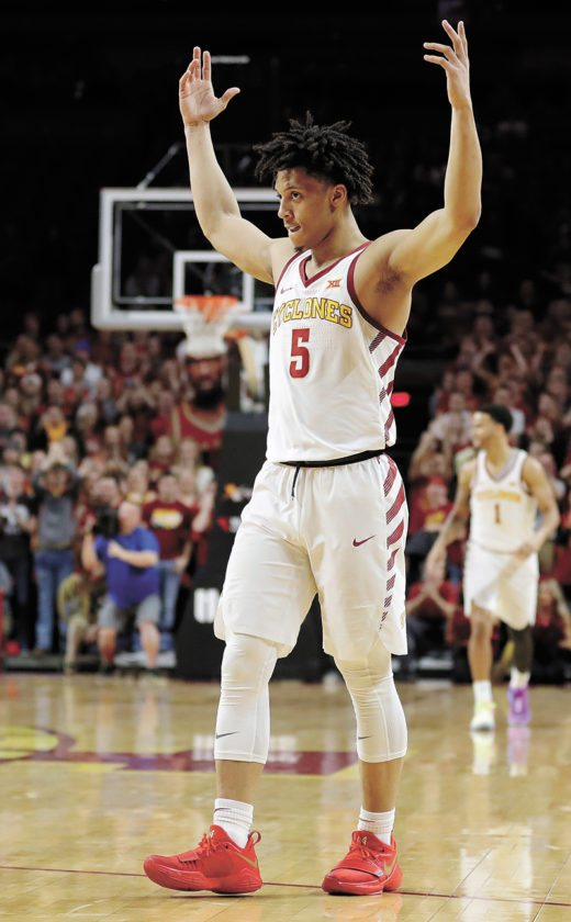 AP PHOTO • Iowa State guard Lindell Wigginton (5) celebrates at the end of the Cyclones' first Big 12 Conference win this season Saturday at Hilton Coliseum in Ames. Wigginton scored 30 points as Iowa State won 75-65.