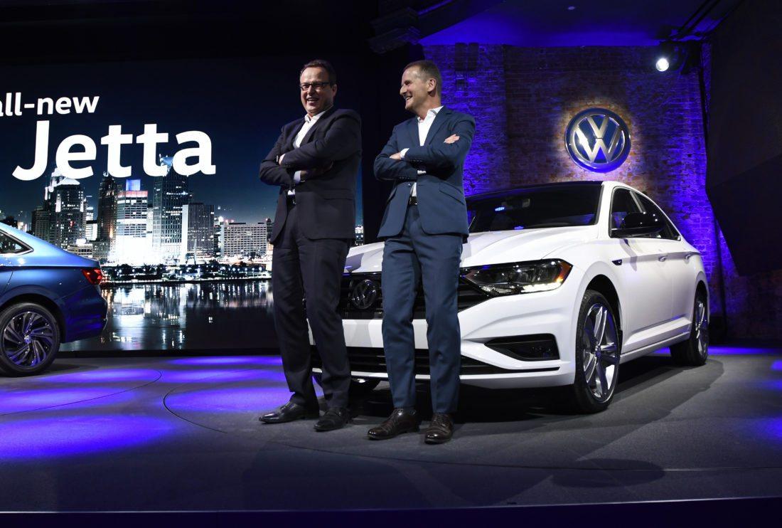 Volkswagen CEO of the North American Region Hinrich J. Woebcken, left, and Herbert Diess, Member of the Board of Management of Volkswagen AG, stand with the 2019 Volkswagen Jetta at the North American International Auto Show, Sunday, Jan. 14, 2018, in Detroit. (AP Photo/Jose Juarez)
