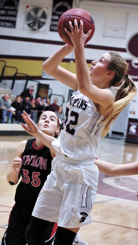 T-R PHOTO BY THORN COMPTON • Grundy Center junior Brooke Flater, center, shoots a fadeaway jumper in the paint to score the first points of the night for the Spartans in their 44-15 win over Union Community on Monday night.