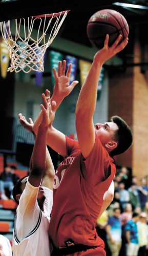 T-R PHOTO BY ADAM RING • Marshalltown's Luke Appel shoots for two of his team-leading 22 points during the Bobcats' loss at Ames on Tuesday night.