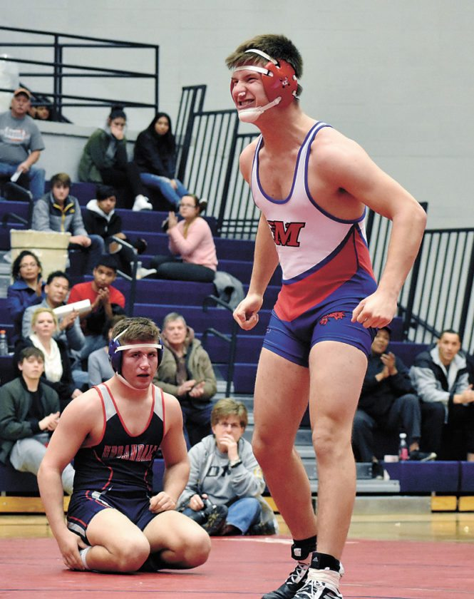 T-R PHOTO BY THORN COMPTON • Marshalltown senior Chayton French, right, celebrates after pinning Urbandale's Adam Fraher to close out the Bobcats' win over the J-Hawks in their final home dual meet of the season.