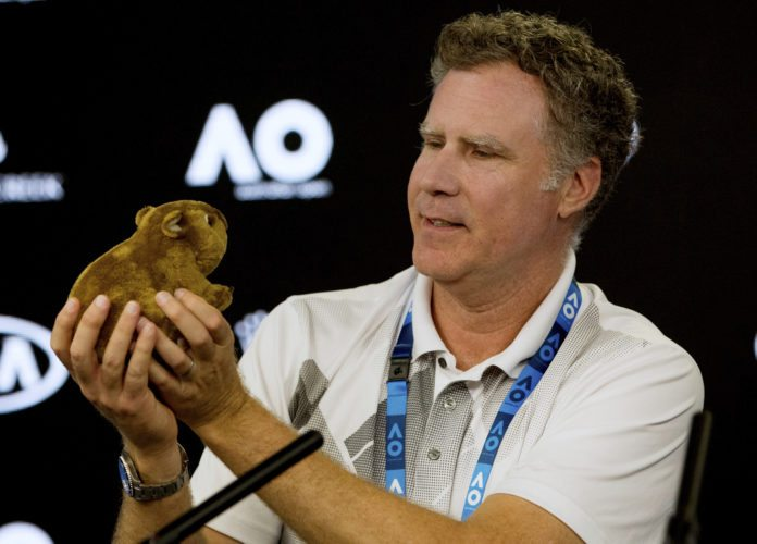 U.S. actor Will Ferrell holds up a toy wombat during a press conference at the Australian Open tennis championships in Melbourne, Thursday, Jan. 18, 2018. (Fiona Hamilton/Tennis Australia via AP)