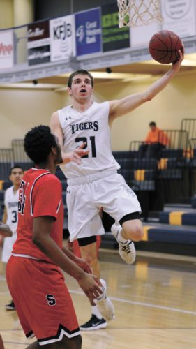 T-R PHOTO BY ROSS THEDE • Marshalltown Community College's Goran Vidovic (21) glides to the basket during the second half of Wednesday's Iowa Community College Athletic Conference game against Southeastern CC. Vidovic scored 11 points in the Tigers' 71-66 loss to the visiting Blackhawks.