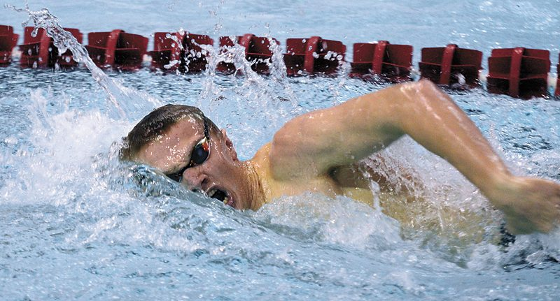 T-R PHOTO BY ROSS THEDE • Marshalltown's Brad Barkema, a senior at BCLUW, swims the opening leg of the Bobcats' winning 400-yard freestyle relay during Thursday's meet against Fort Dodge. The MHS foursome of Barkema, Nash Perisho, Caleb Summers and Gage Petty won the final race in a combined time of 3 minutes, 35.29 seconds, to seal the dual meet win.
