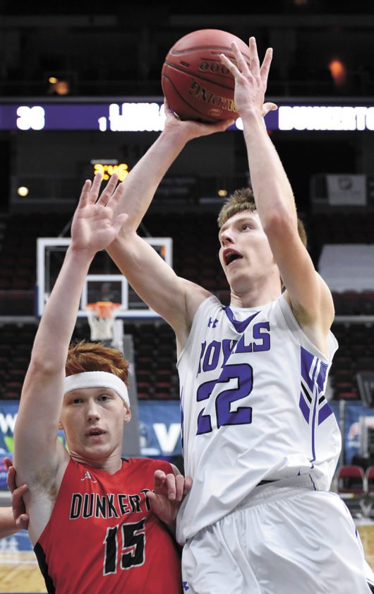 T-R PHOTO BY THORN COMPTON • Dunkerton's Travis Schake (15) attempts contest a shot by Colo-NESCO senior Matthew Hill during the fourth quarter of the Raiders' win over the Royals at Wells Fargo Arena on Monday.