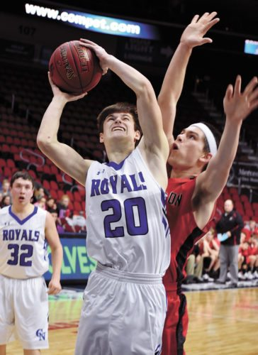 T-R PHOTO BY THORN COMPTON • Colo-NESCO senior Mason Lytle (20) absorbs contact from Dunkerton's Dalton Burch while attempting a shot down low in the fourth quarter of the Royals' loss to the Raiders in Wells Fargo Arena in Des Moines on Monday.