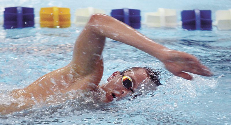 T-R PHOTO BY ROSS THEDE • Marshalltown senior Chris Streets swims his way to second place in the 500-yard freestyle during Tuesday's Bobcat victory against Indianola at the MHS pool, 98-72. Streets finished with a time of 5 minutes, 35.87 seconds.