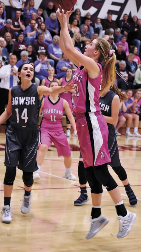 T-R PHOTO BY THORN COMPTON • Grundy Center junior Brooke Flater, right, sends up a shot in the paint while AGWSR senior Mandy Willems (14) attempts to contest during the third quarter of the Spartans' win over the Cougars in Grundy Center on Friday night.