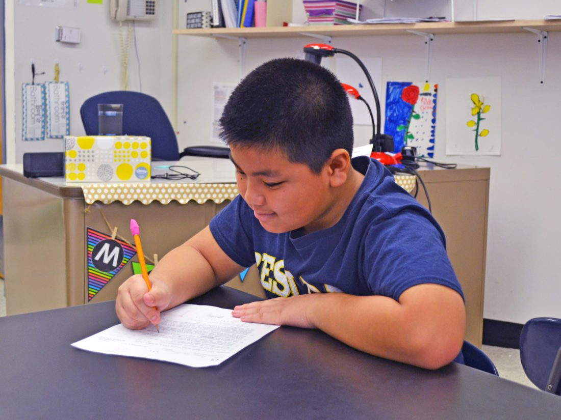 T-R PHOTO BY SARA JORDAN-HEINTZ Thaw Ta Soe, 10, a fourth grader at Hoglan Elementary School, completes advanced coursework. Interested in math, science, and building things, he continues to impress his teachers with his innovative ideas.